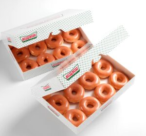 2 boxes of Krispy Kreme original glazed doughnuts to promote buy 1 get 1 dozen for $0.76