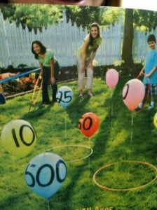 Outdoor party game hula hoop toss over balloons