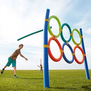 Outdoor party game target station with pool noodles