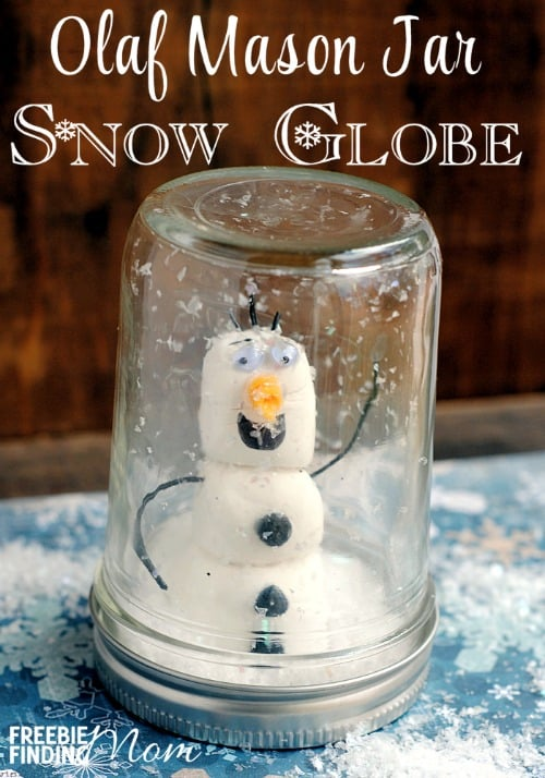 snowman snowglobe jar featuring olaf from frozen in fake snow