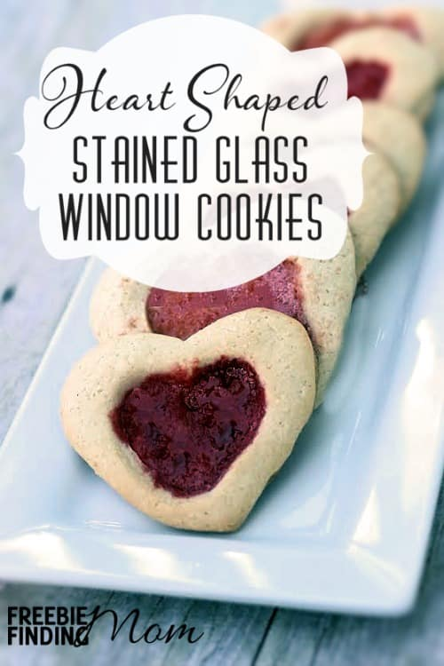Combine a delicious homemade sugar cookie recipe with a yummy hard candy like Jolly Ranchers or Life Savers and you've got Stained Glass Window Cookies. These heart Valentine cookies are perfect for Valentine's Day. Whip up a batch for your honey or for the kids to take to school.