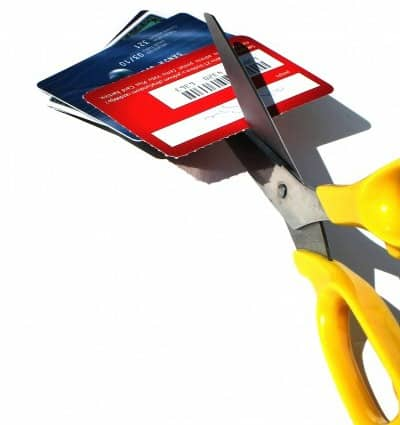 scissor cutting up credit cards to promote ways to fix my credit score