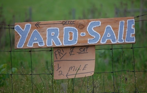 yard sale sign to promote ways to earn cash
