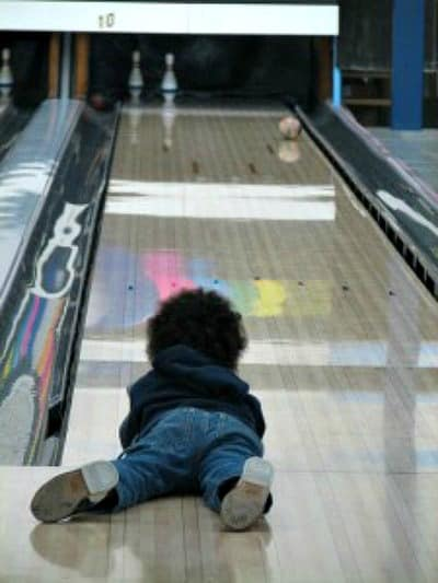 picture of a child bowling to promote free summer activities for kids
