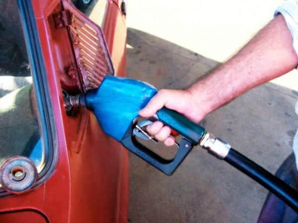Pumping gas to promote saving money with gas rewards programs