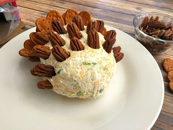 Insert pecans into the top and sides of cheeseball