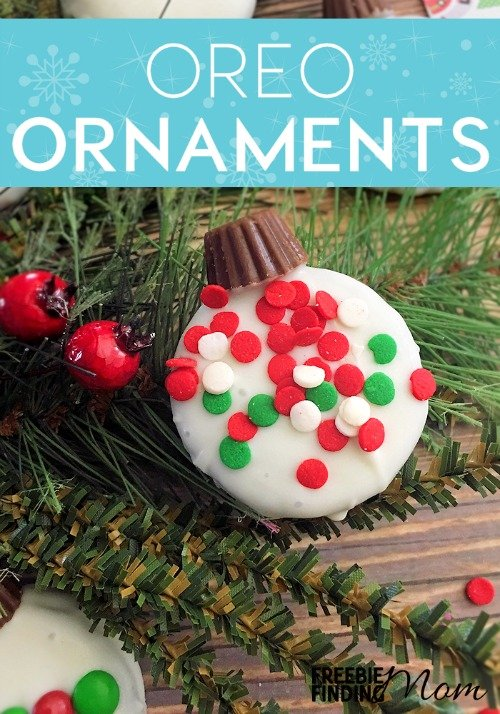 Need an easy and delicious Christmas cookie recipe that is perfect for making with the kids? This Oreo Ornament Cookies recipe transforms plain Oreos into adorable Christmas tree ornaments by simply dipping them into white chocolate, placing a Reese's Peanut Butter Cup Mini on the top then coating them with sprinkles or mini M&M's. This fun and festive holiday dessert idea is great for cookie exchange parties or DIY gifts for friends and family.