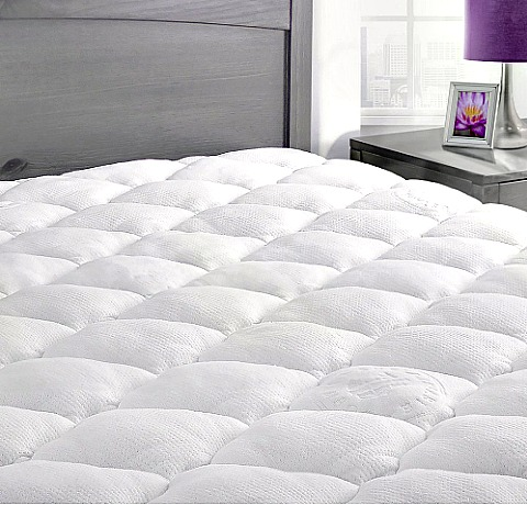 Bamboo mattress pad on the bed