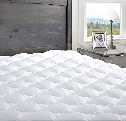 Pressure Relief Mattress Pad with Fitted Skirt on bed