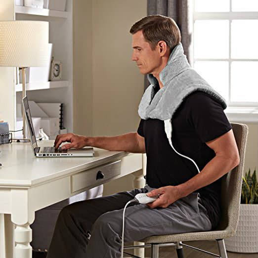 Sunbeam Renue Contouring Neck and Shoulder Heating Pad in use