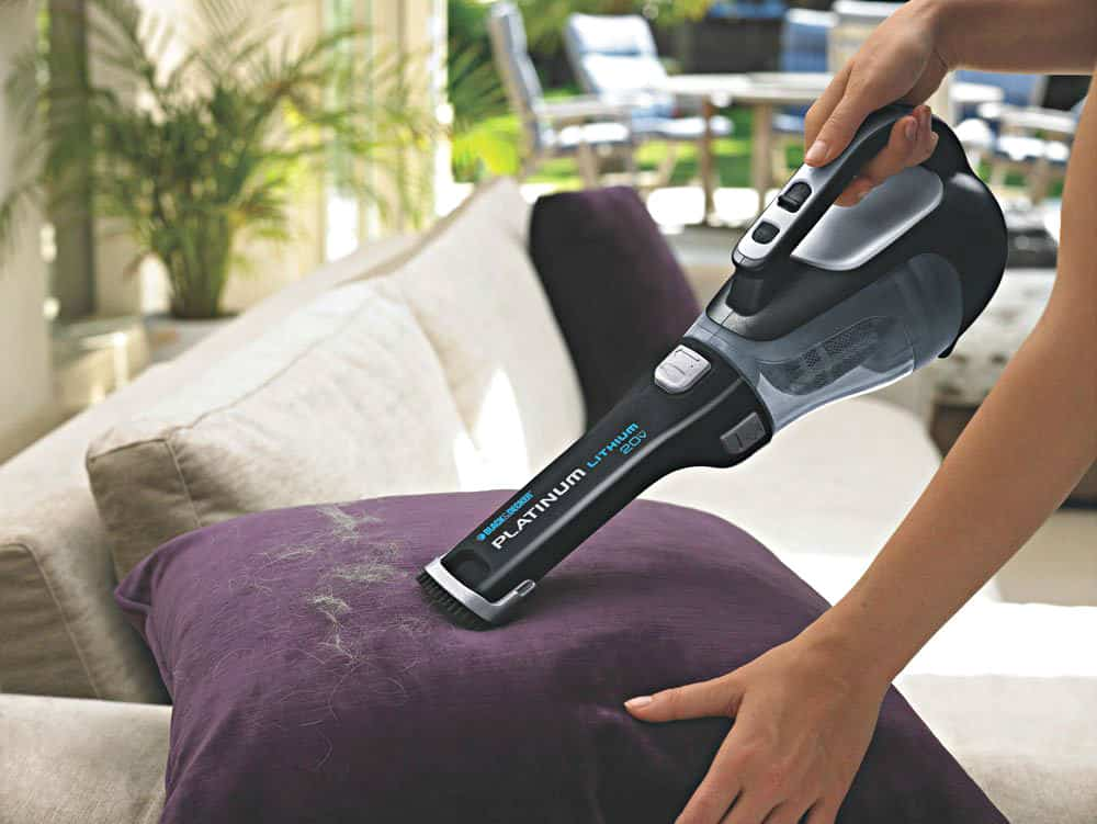 20-Volt BLACK+DECKER Cordless Hand Vacuum in use