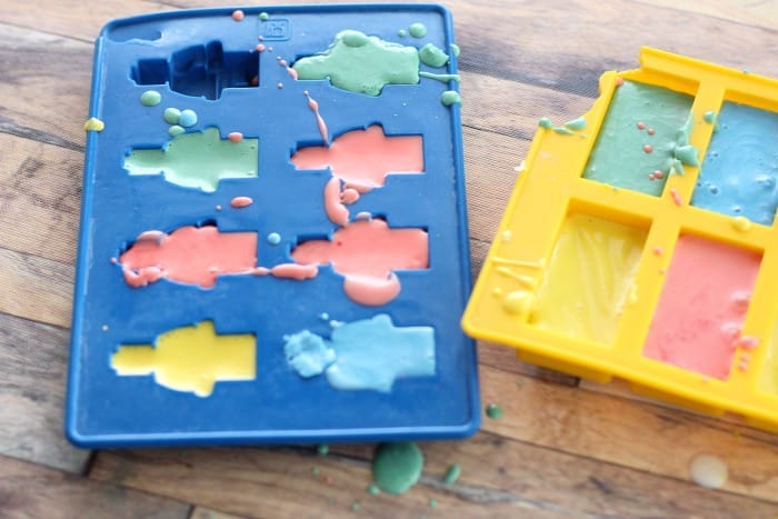 add colored mixture to molds for homemade crayons for toddlers