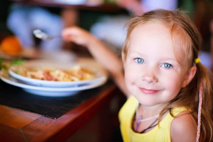 girl eating in restaurant