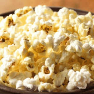 Popcorn popped in coconut oil is a healthy and easy alternative to store-bought microwave popcorn.