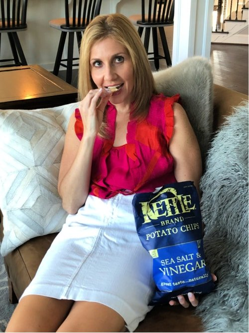 Woman Eating Kettle Brand Chips on a Couch