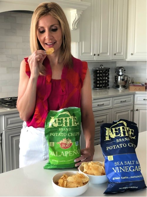 Woman eating Kettle Brand Chips