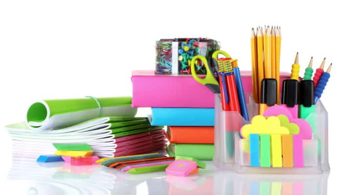 College school supplies like highlighters, books, notes, erasers, papers, and pencils