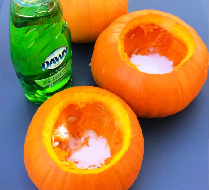 Next, add the bubble bubble toil and trouble to the pumpkin volcano in the form of dish soap