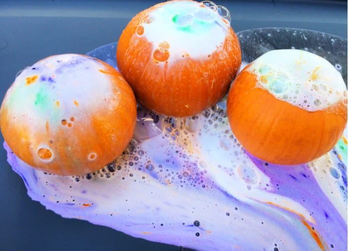 Volcano activities for preschoolers can be messy but that's part of the fun; stand back and watch the pumpkin volcanoes erupt