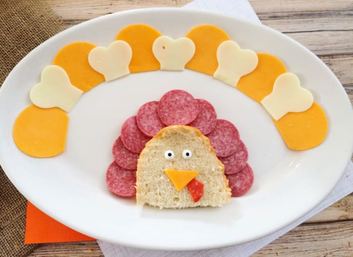 Cookie cutters make cutting the cheese for this turkey shaped cheese and crackers tray a breeze