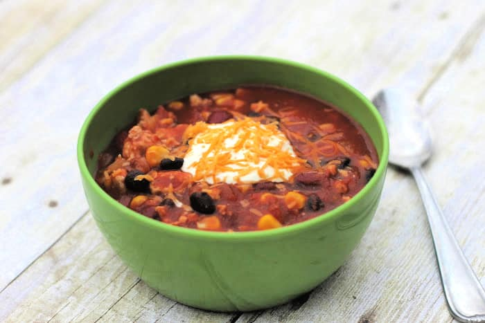 Make the best healthy turkey chili recipe crock pot dinner even better by topping it with cheese and sour cream