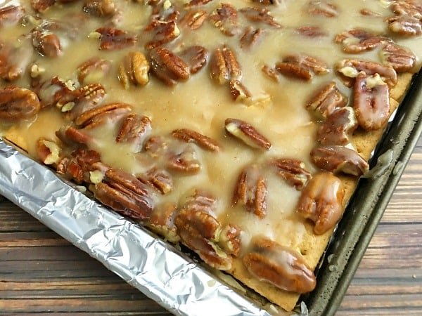 To make this pecan dessert recipe pour the pecan dessert mixture into an aluminum foil lined baking sheet and spread evenly before baking for 8 minutes