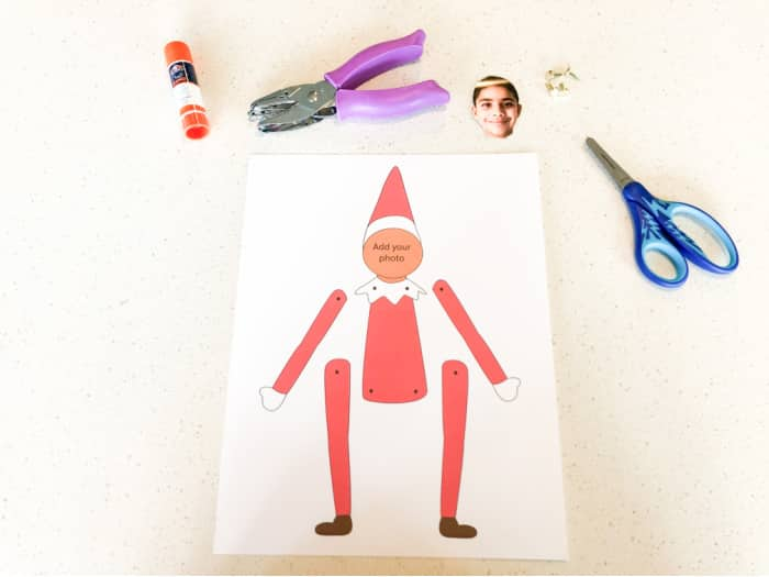 You only need a few supplies to, like scissors, brads, and glue, to pull off the elf yourself template printable activity