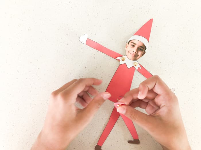 The last step in making this moveable elf yourself template printable is to attach the legs behind the body