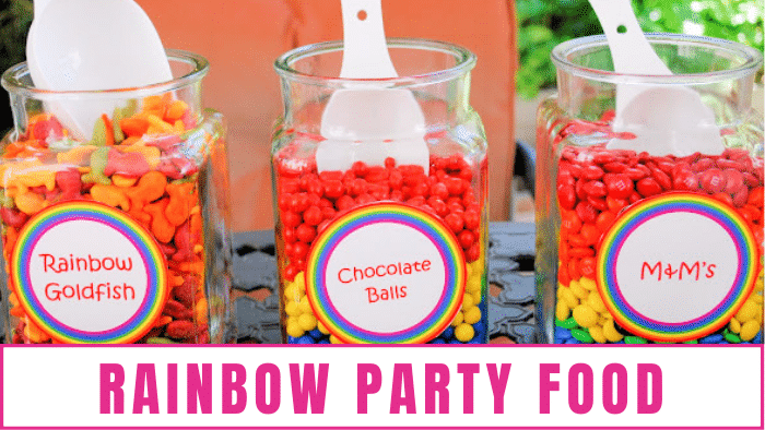Large jars of rainbow goldfish, chocolate balls, and M&Ms are the perfect rainbow theme party ideas