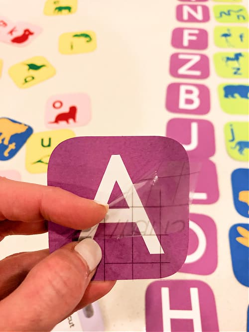 Remove the transfer tape so you can begin putting your letter games kindergarten and preschool together.
